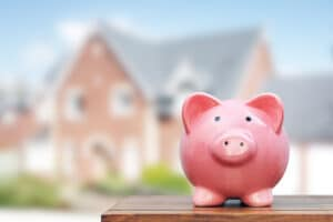 Piggy bank in front of house